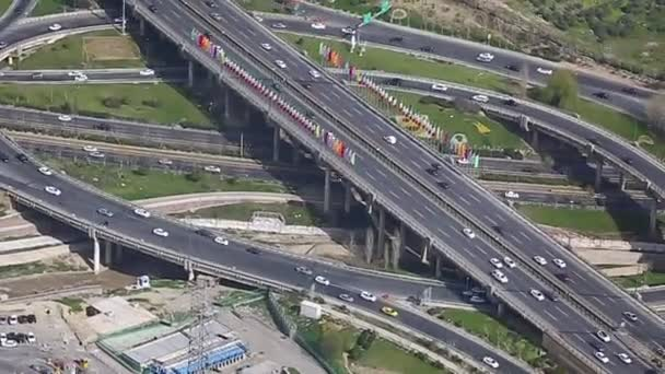 Traffic jam concept. Cars and lorries wait for their turn to move. Aerial view of highway interchange.