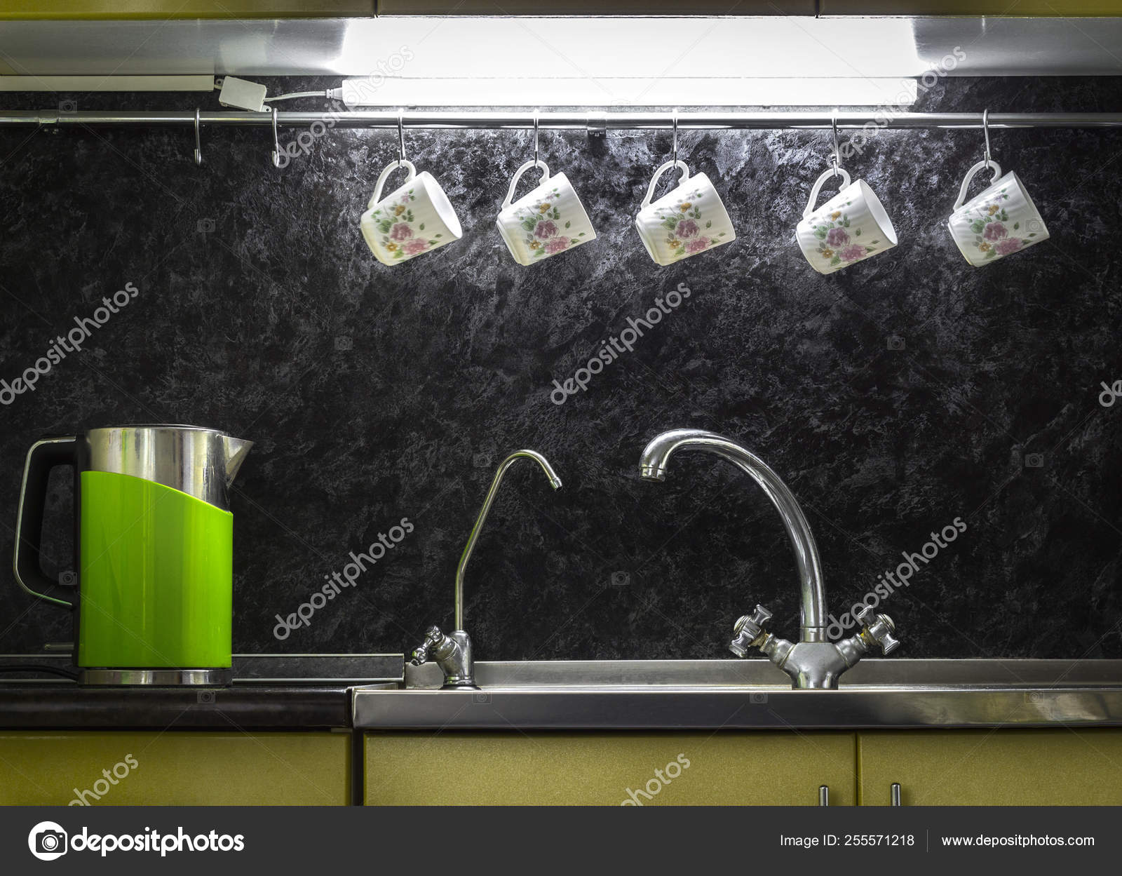 Close up to a stainless steel kitchen sink