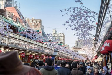 TOKYO, JAPAN - MARCH 22, 2017 : Nakamise shopping street has a lot of shop for food, dessert and gifts before sensoji temple, Asakusa, Tokyo, Japan