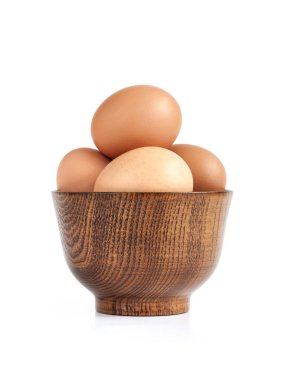 organic eggs traditional ingredient of thai food in wooden bowl isolated on white background