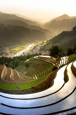 The image of terraced field is as beautiful as the oil painting. The curved lines of terraced rice field during the watering season at the time before starting to grow rice in Mu Cang Chai