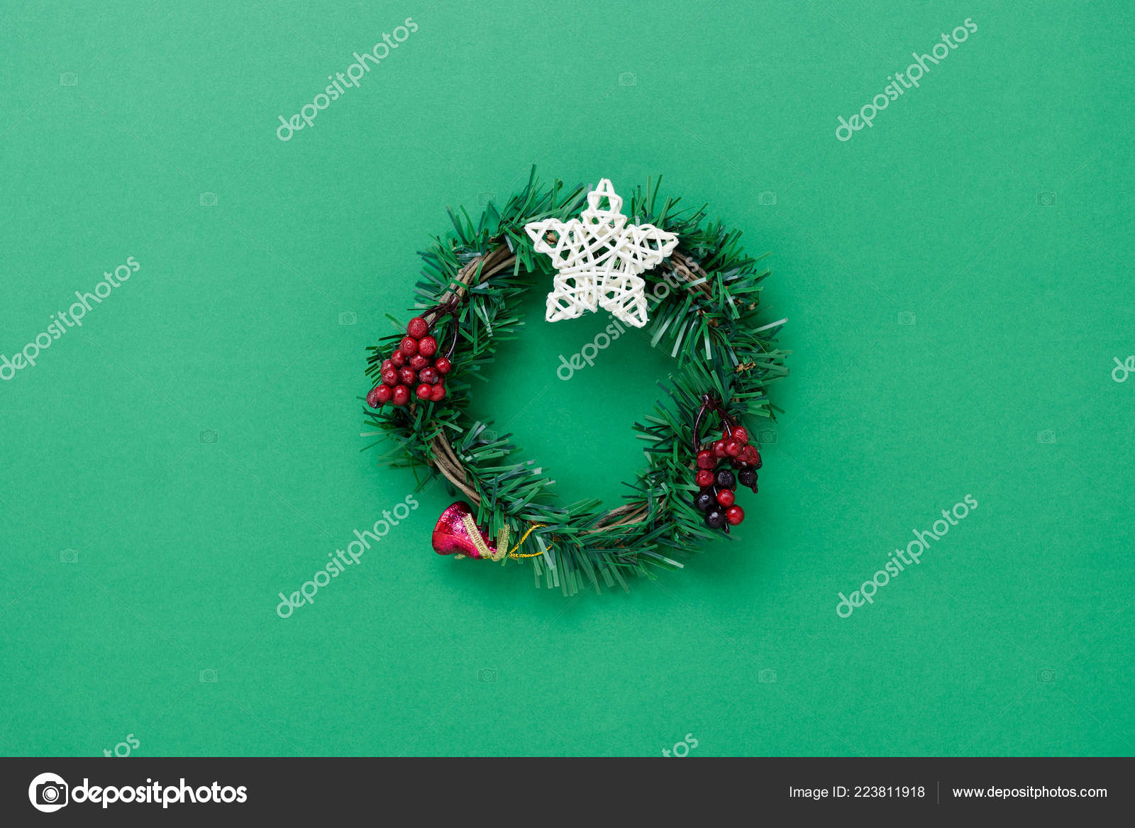 table top view of merry christmas decorations happy new year ornaments conceptflat lay essential objects the circle wreath on modern rustic green paper