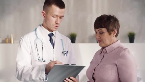 Aged pretty woman is listening confident professional helping physician