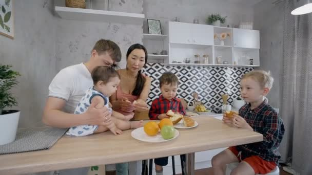 Two parents spending time with kids at home