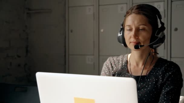 Call center operator speaking with people using headset