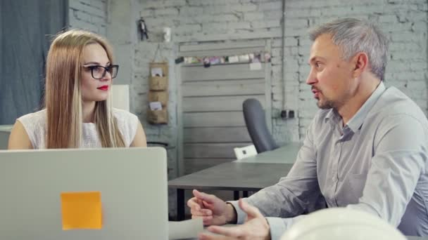 Collaboration in office of man and his assistant lady