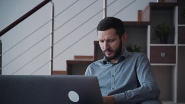 Man using laptop and sitting at home