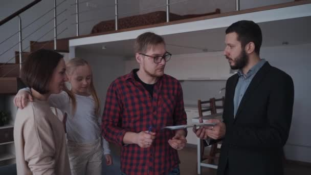 Real estate agent shaking hands to his customer after buying new