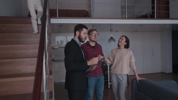 Woman and man talking about rent house with real estate agent