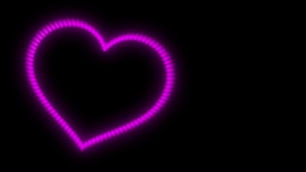 pulsující srdce, růžová neon světlo na černém pozadí