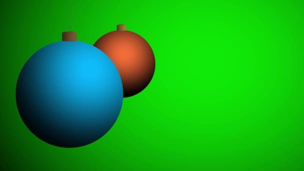 Rudé vánoční kuličky na zeleném pozadí