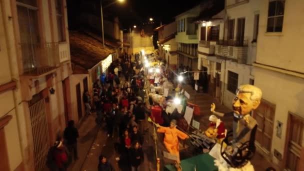 Cuenca, Ecuador - December 31, 2018 - Drone flies along street showing installation art on New Years Eve