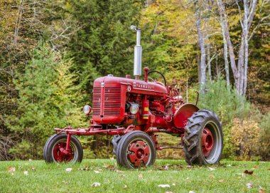 Exeter, New Hampshire - October 13, 2018 - old red tractor sits in yard.