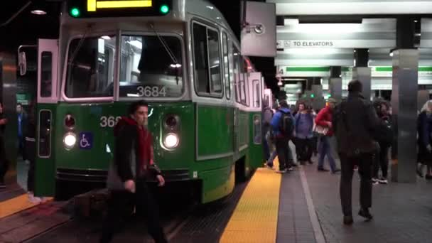 Boston, Massachusetts-20181024-Time Lapse-Train Arrives People Enter and  Leave and Walk Across Tracks