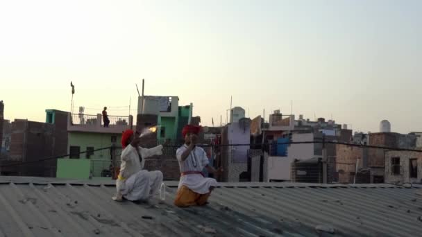 Kaputhli, India - 20180227 -  Two Fire Breathers On Rooftop Show Their Skill.