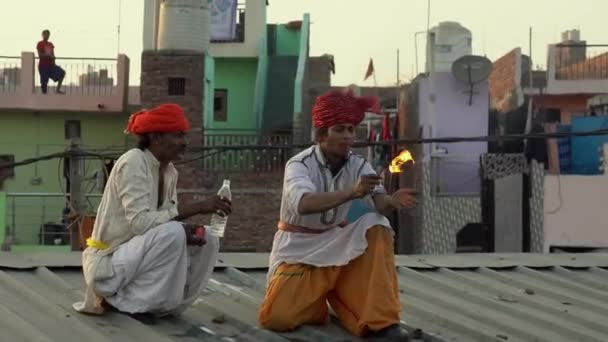 Kaputhli, India - 20180227 - Fire Breather On Rooftop Shows His Skill.