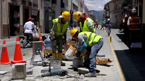 Cuenca, Ecuador  -  20180920  -  Worker Pours Grout Into Bucket To Mix.