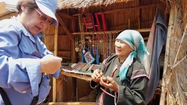 Mae Saiong. Thailand - 2019-03-11 - Indigenous Woman Accepts Money For Her Sale