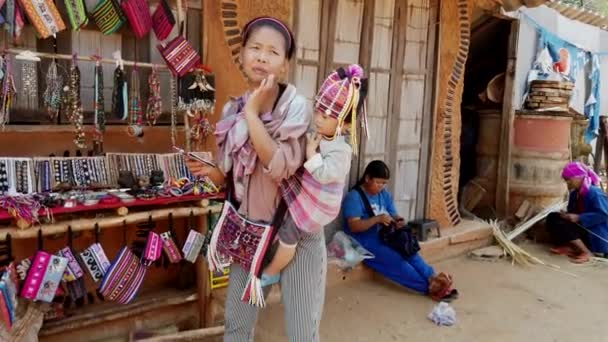 Mae Saiong. Thailand - 2019-03-11 - Woman With Baby On Back Tried To Sell Her Bead Wares