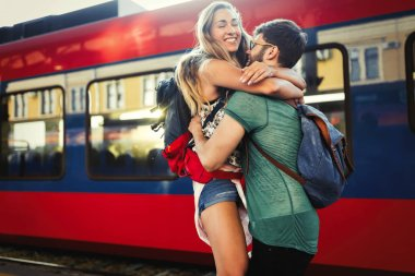 Couple in love  reunion after traveler arrives