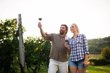 Winegrower family tasting wine