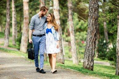 Beautiful couple bonding by walking  in park