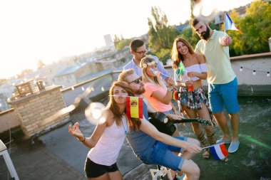 Group of friends enjoying party. Friends having fun at rooftop party.
