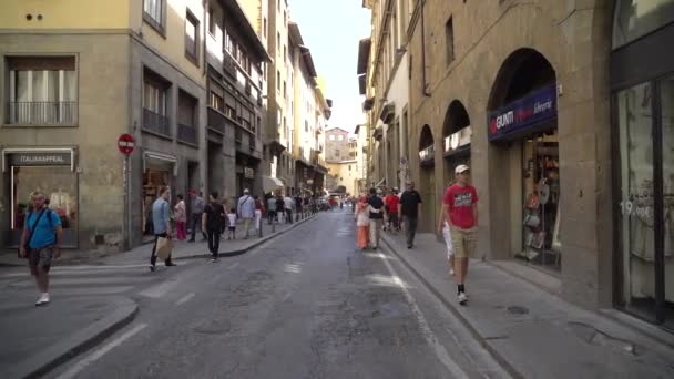 Florence, Italy - 24.06.2018: tourists in the narrow streets of florence