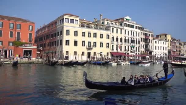 Venice, Italy - 14.03.2019: gondola with tourists in the narrow canals of Venice