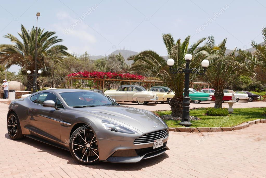 Lima, Peru. November 11, 2017. Front and side view of a mint condition gray Aston Martin Vanquish coupe at south of Lima. This car was produced between 2001 and 2007 in the UK. the photo was taken in a retromobile show on a sunny day