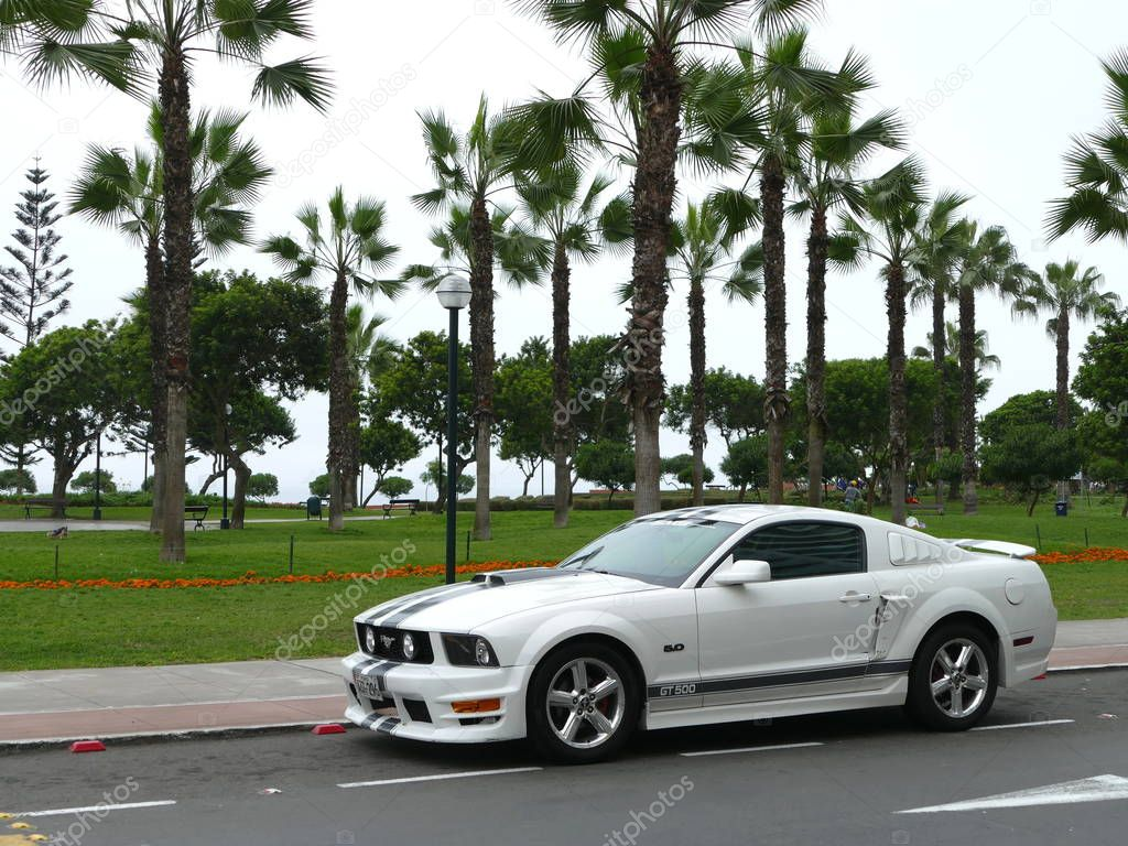Lima, Peru. October 30, 2017. Front and side view of a mint condition white and black Ford Mustang GT500 5.0 V8 with aluminium wheels built by Ford Motor Company in the USA. The photo was taken in Miraflores district of Lima park.