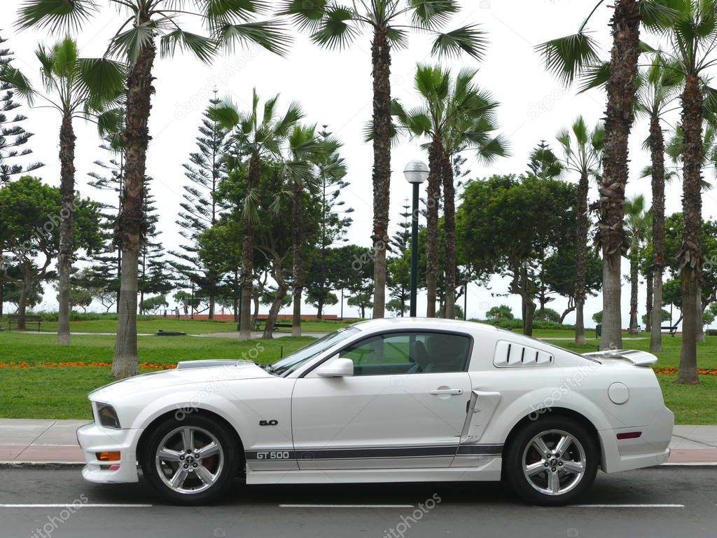 Lima, Peru. October 30, 2017. Skill condition of a white and black Ford Mustang GT500 5.0 V8 with aluminium wheels built by Ford Motor Company in the USA and parked alongside a park in Miraflores district of Lima. The photo was taken on a clear day