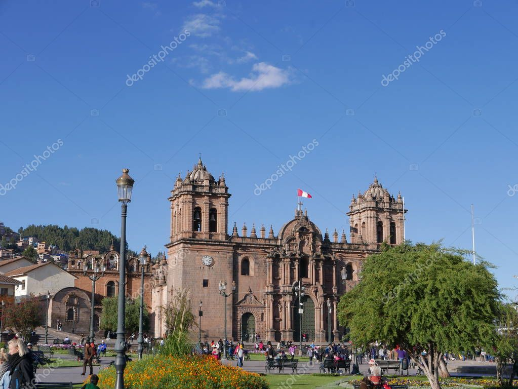 Cusco, Peru. July 10, 2017. The main square of Cusco city called 'Plaza de Armas' with the cathedral and church in the background, Peru