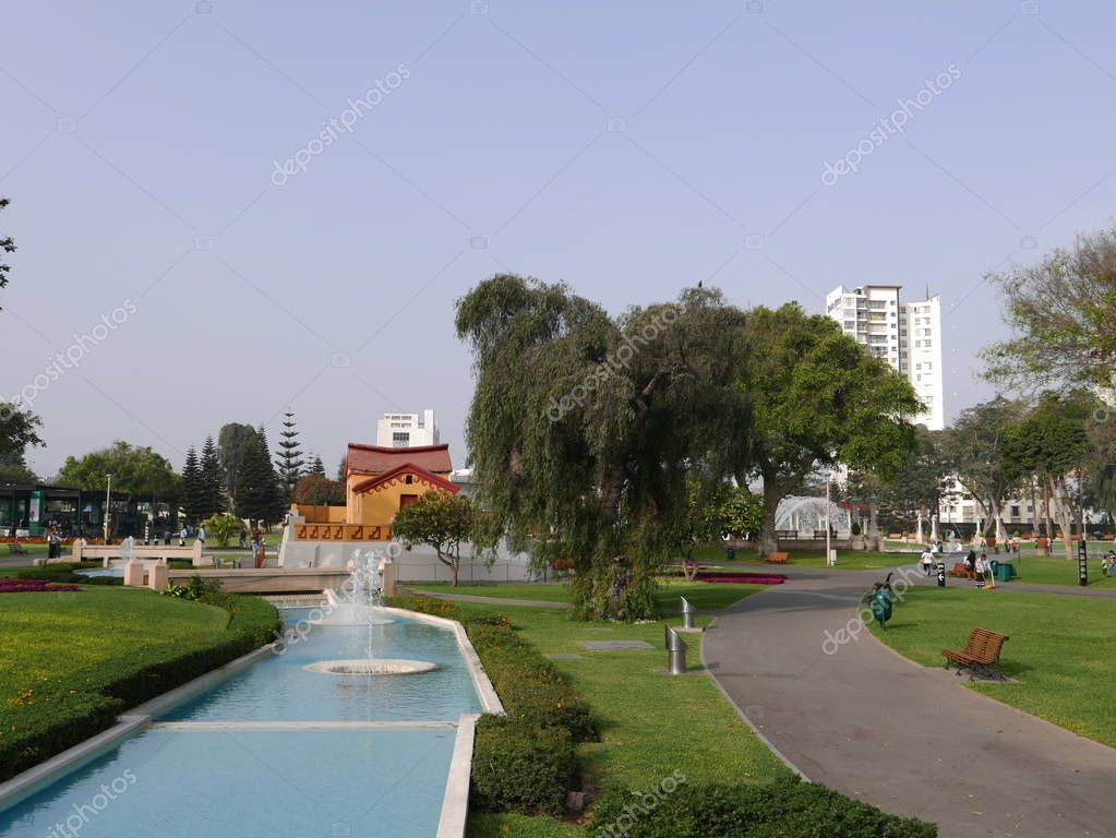 Scenic view of a river flowing water fountain that ends in a yellow and red house located in  the Magic Water Circuit in Lima public Reverve Park. It is the world's largest fountain complex in a park, making it worthy of the Record Guinness Award