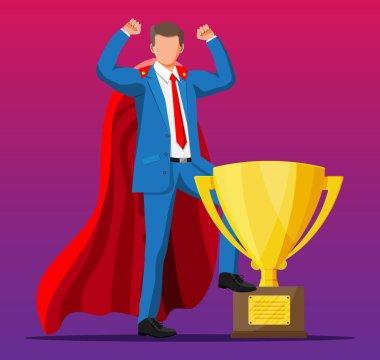 Super businessman in cloak goes to golden trophy.