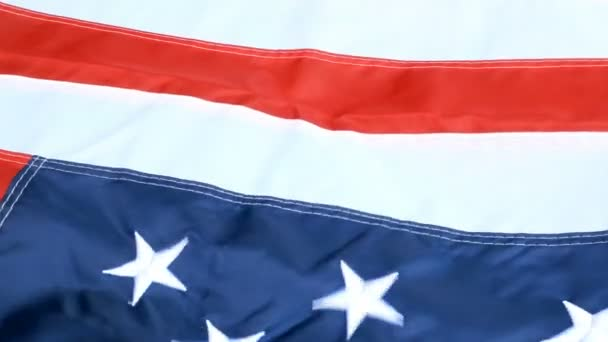 Beautifully waving on wind, star and stripes, flag of United States of America. Red, white and blue. 4th july concept background. Symbol of freedom and democracy.