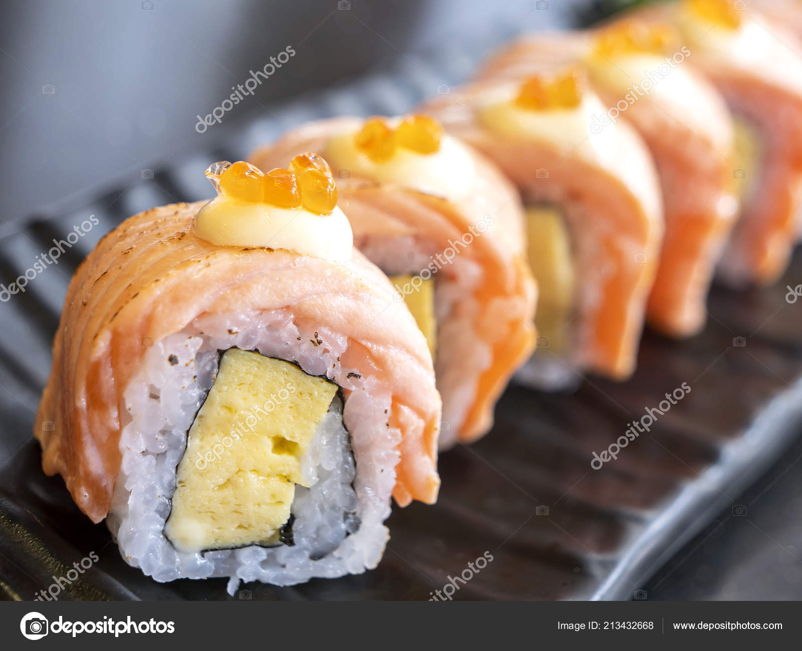 Close Grill Salmon Roll Sushi Black Dish Restaurant Selective Focus Stock Photo Image By C Npstockphoto 213432668
