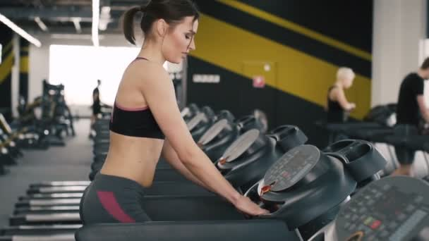 Pretty and young girl jogging in gym