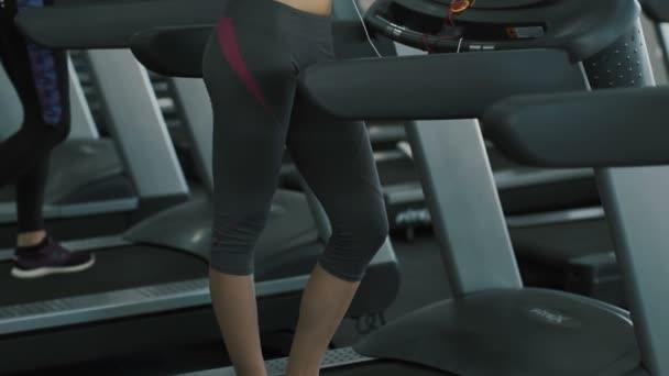 Fit body girl running in gym