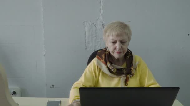 Senior woman work at laptop in the office