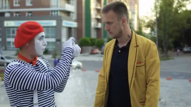 Magician has fun with funny mime