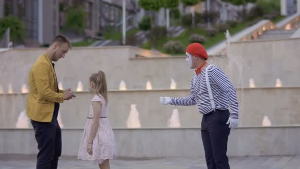 Mime and magician fighting for the girls attention showing her their skills