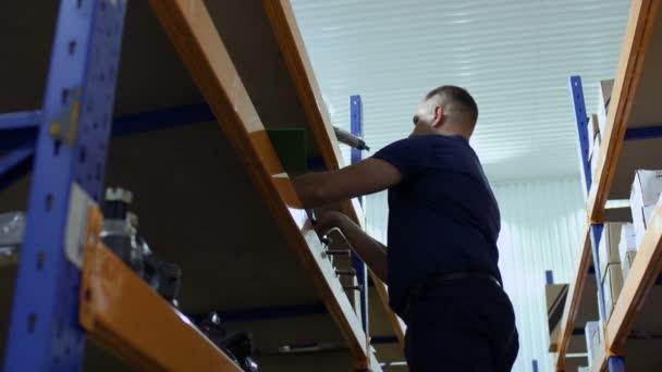 Storekeeper make inventory at machinery storage