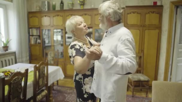 Senior man dancing with his wife at home