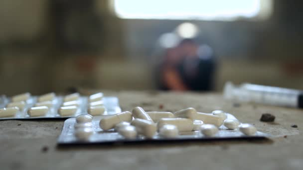 Two people kissing against the background of pills and syringe