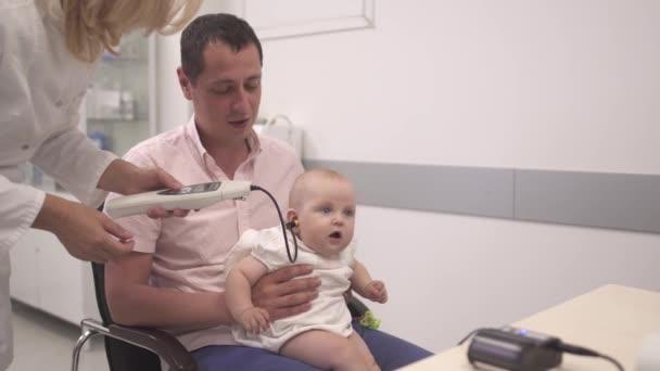 Nurse examines a baby