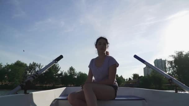 Beautiful girl sitting sad in a boat