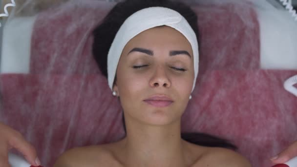 Beautiful girl in massage salon