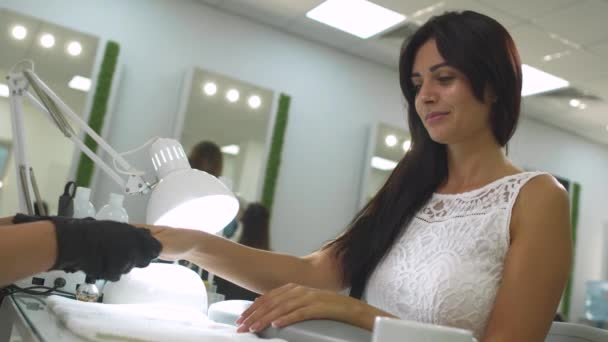 Charming girl in a manicure salon