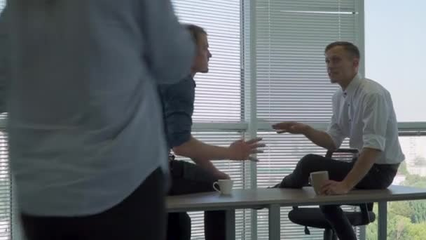 Two business partners sit on the table and see off the girl